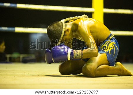 CHANG, THAILAND - FEB 22: Unidentified Muaythai fighter in ring during match, Feb 22, 2013 on Chang, Thailand. For many Thai men Muaythai only way to break out of poverty, per battle pay to 7000 baht. - stock photo