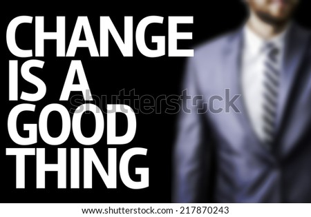 Change Is A Good Thing written on a board with a business man on background - stock photo