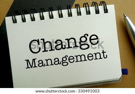 Change management memo written on a notebook with pen - stock photo