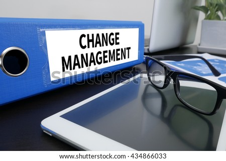 CHANGE MANAGEMENT Office folder on Desktop on table with Office Supplies. ipad - stock photo
