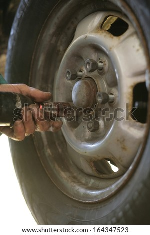 change of tyres for coming cold winter - stock photo