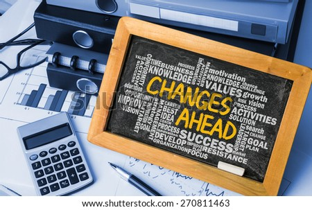 changes ahead concept with related word cloud hand drawing on blackboard - stock photo