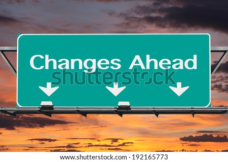 Changes ahead freeway road sign with sunset sky.   - stock photo