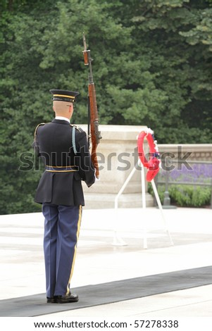 Changing of the guard ceremony at the Tomb of the Unknowns at the Arlington National Cemetery - stock photo