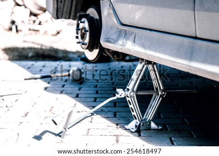 Changing tires or wheel before winter or spring - stock photo