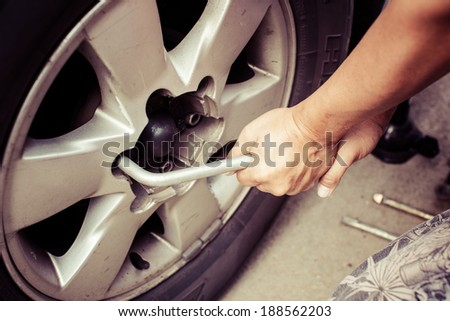 Changing tires or wheel, process color - stock photo