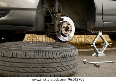 Changing wheel on a car - stock photo