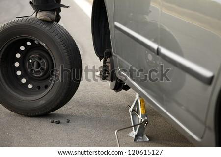Changing wheels on a car - stock photo