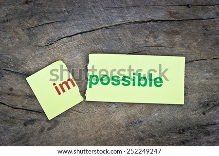 Changing word impossible transformed to possible. Conceptual of successfully overcoming problems. - stock photo