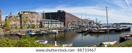 Channels in Amsterdam. Modern residential districts. Marina for boats and yachts. - stock photo