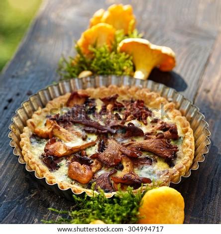 Chanterelle mushrooms quiche - stock photo
