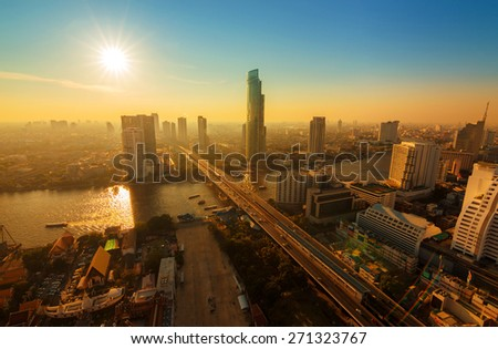 Chao Phraya river and high building sky scrapper in heart of ban - stock photo