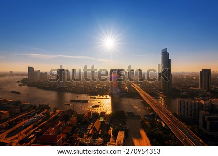 Chao Phraya river and high building sky scrapper in heart of Bangkok - stock photo