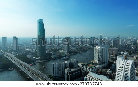 Chao Phraya river and high building sky scrapper in heart of bangkok thailand - stock photo