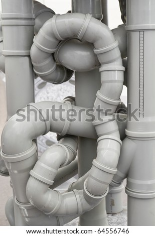 Chaos of drain pipes - stock photo