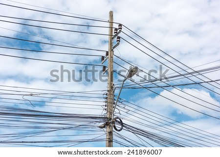 Chaos of the cable in the sky - stock photo