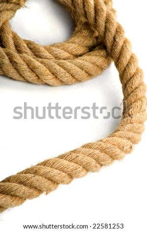 Chaotic coils of a thick rope on a white background - stock photo