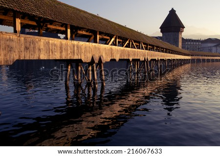 Chapel Bridge at sunset in Lucerne, Switzerland - stock photo