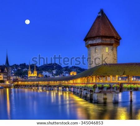 Chapel bridge or Kapellbrucke by night, Lucerne, Switzerland - stock photo