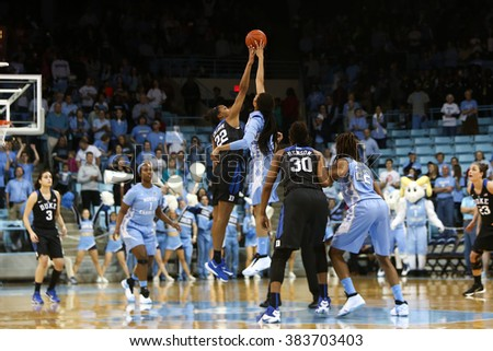 CHAPEL HILL, NC-FEB 28: Duke Blue Devils forward Oderah Chidom (22) and UNC Tar Heels forward Hillary Summers (30) jump for the ball on February 28, 2016 at Carmichael Arena. - stock photo