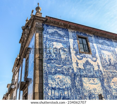 Chapel of Souls in Porto, covered by white and blue drawn tiles in Porto, Portugal. - stock photo