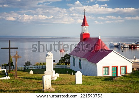 Chapel of Tadoussac, historical monument built of wood in 1747. The red-roofed Chapel overlooks the St Lawrence river. Quebec, Province, Canada. - stock photo