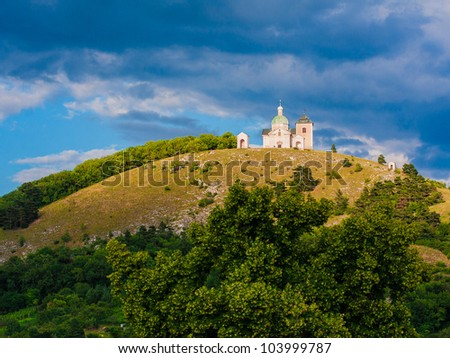 Chapel on top of a round hill - stock photo