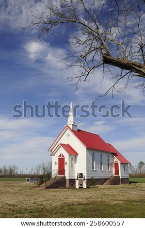 Chapel with White Wood Siding and Red Roof - stock photo