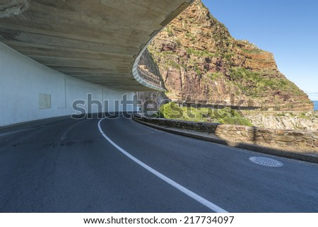 Chapman's Peak Drive in Cape Town, which takes motorists on a 9km winding route from Hout Bay to Noordhoek, is widely regarded as one of the most scenic drives in South Africa - stock photo