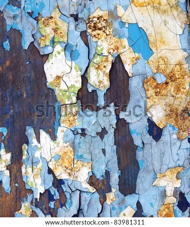 Chapped paint on wooden background - stock photo