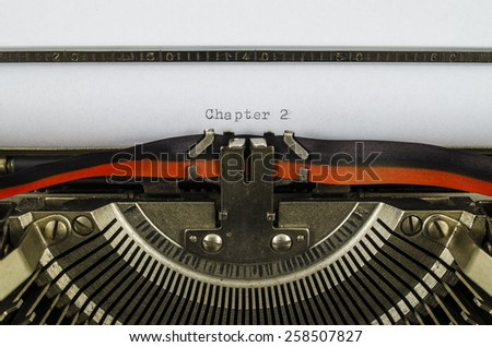 Chapter 2 word printed on an old typewriter - stock photo