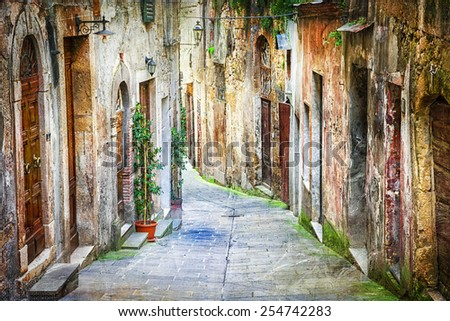 characteristic old streets of medieval towns of Italy - stock photo
