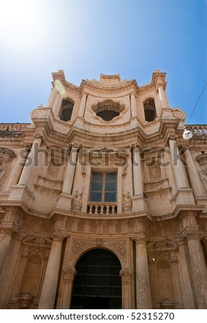 Characteristic windows opened in a ancient wall of old building - stock photo