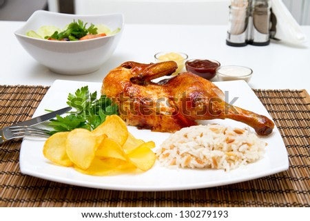 Charcoal baked chicken and side dishes - stock photo
