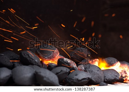 Charcoal briquettes ready for barbecue grill. - stock photo