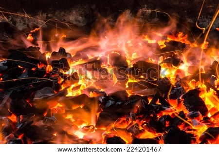 Charcoal Burning in BBQ or in the Fireplace Frame Background  - stock photo