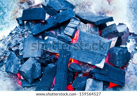 Charcoal fire on a sheet of aluminum - stock photo