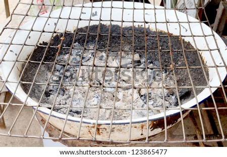 Charcoal stove is not fires with grill. - stock photo