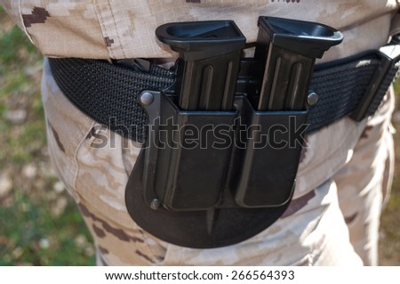 Chargers pistol hanging from a belt - stock photo