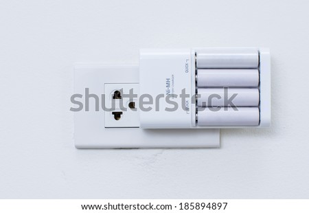 Charging AA Batteries  - stock photo