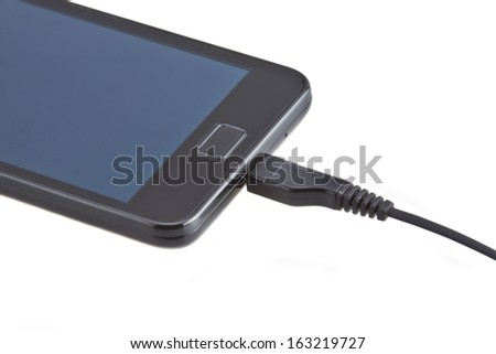 Charging of mobile phone - stock photo