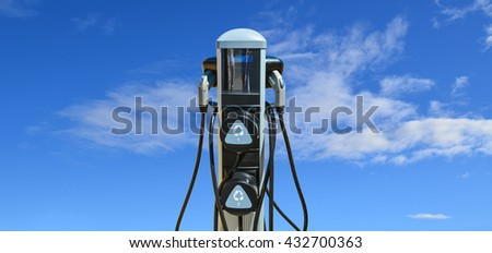 Charging station for zero emission cars on cloudy sky background. Infrastructure for green sustainable future of the planet. EV - electric vehicle charging station. Electric car charging point - stock photo