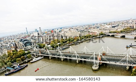 Charing cross station and bridge seen from the London Eye - stock photo