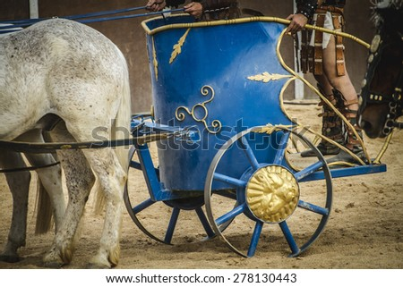 chariot race in a Roman circus, gladiators and slaves fighting - stock photo