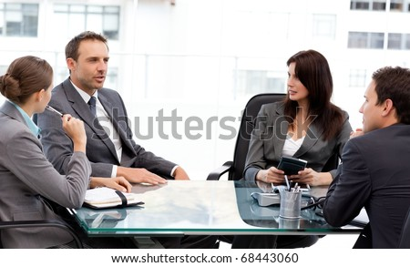 Charismatic businessman talking to his partners during a meeting at work - stock photo