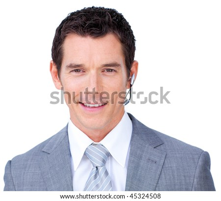 Charismatic male executive with headset on against a white background - stock photo