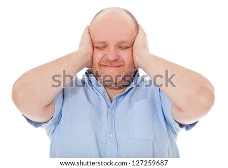 Charismatic middle aged man keeps his ears shut. All on white background. - stock photo