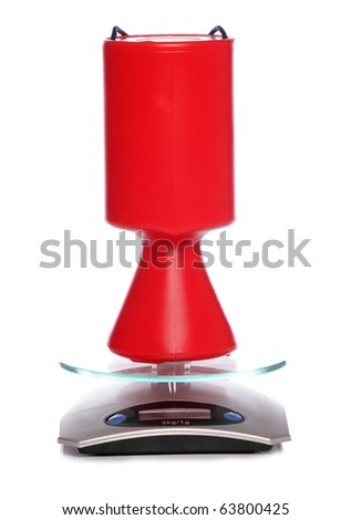 Charity collection tin on scales - stock photo