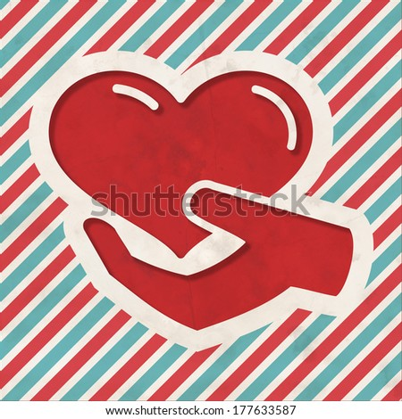 Charity Concept - Icon of Heart in the Hand on Red and Blue Striped Background. Vintage Concept in Flat Design. - stock photo