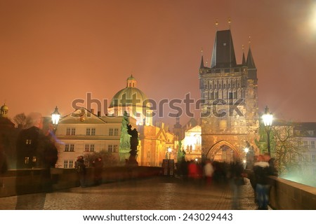 Charles bridge and church dome and Gothic tower in foggy night, Prague, Czech Republic - stock photo